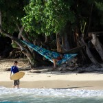 skim boarding in Fare while Lili (s/v Liward) reads in a hammock