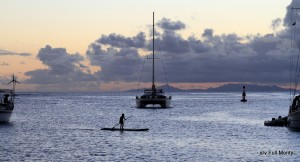 a young Huahine boy enjoying an evening paddle
